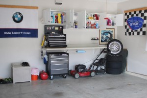 Garage with wall cabinets open